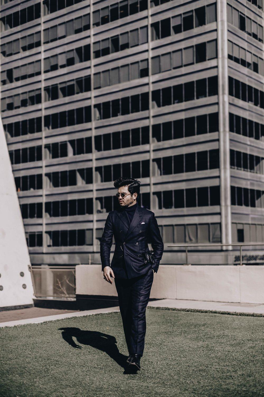 Wearing:  Custom made windowpane double-breasted suit by  Institchu.   Sunglasses:  Vintage Giorgio Armani   Photographed by  Kim Geronimo  @thestreetsensei