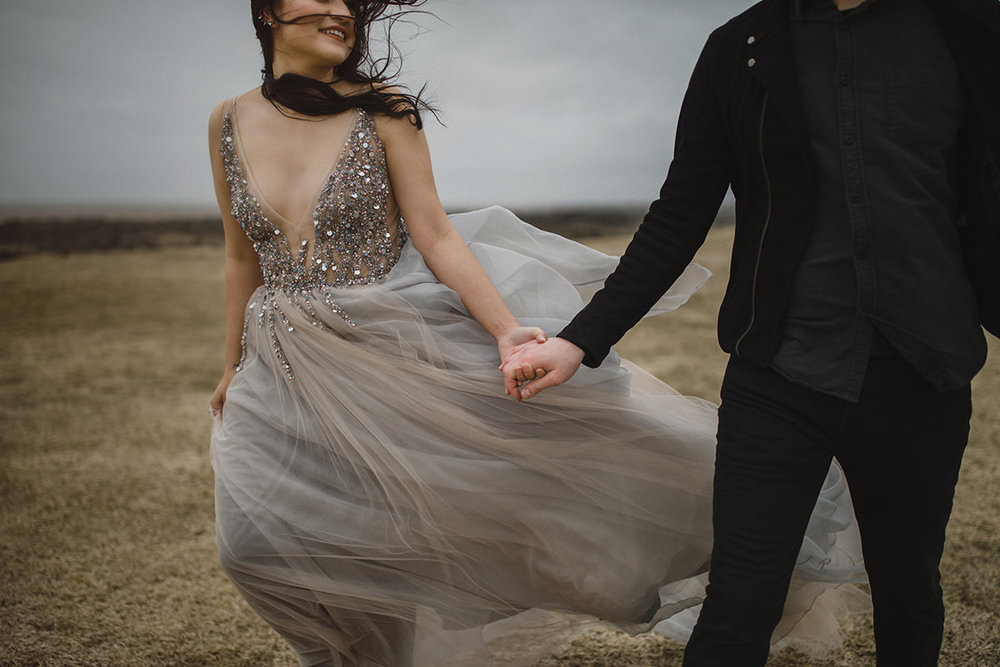 gabe mcclintock iceland elopement wedding couple love photographer photography engaged engagement couples elope berta evening gown fall gray grey wedding dress liz osban jarret