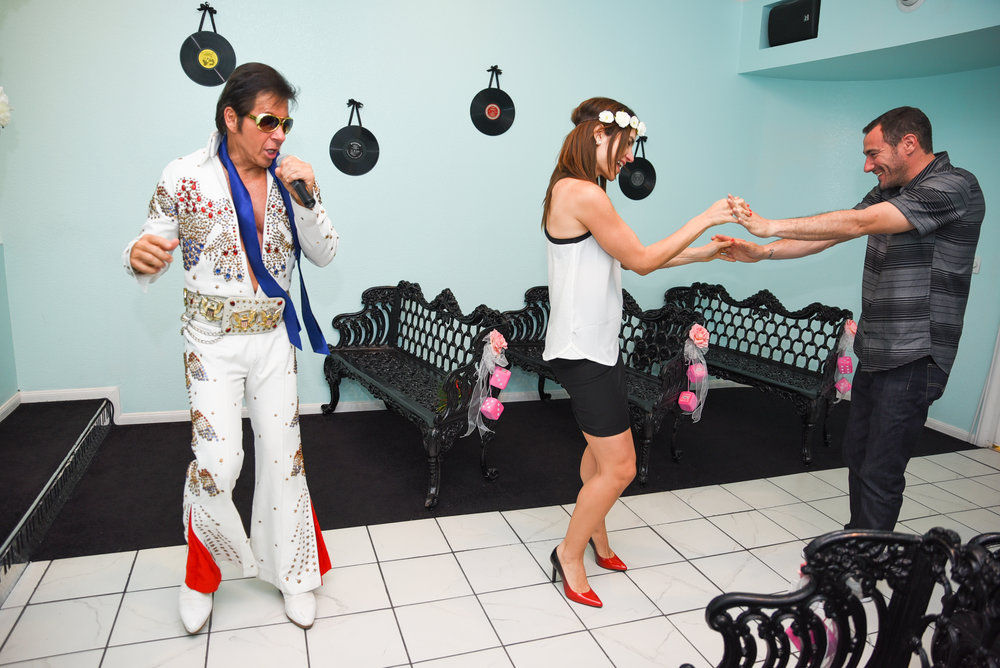 Elvis sings while husband and wife dance in the rock n roll chapel