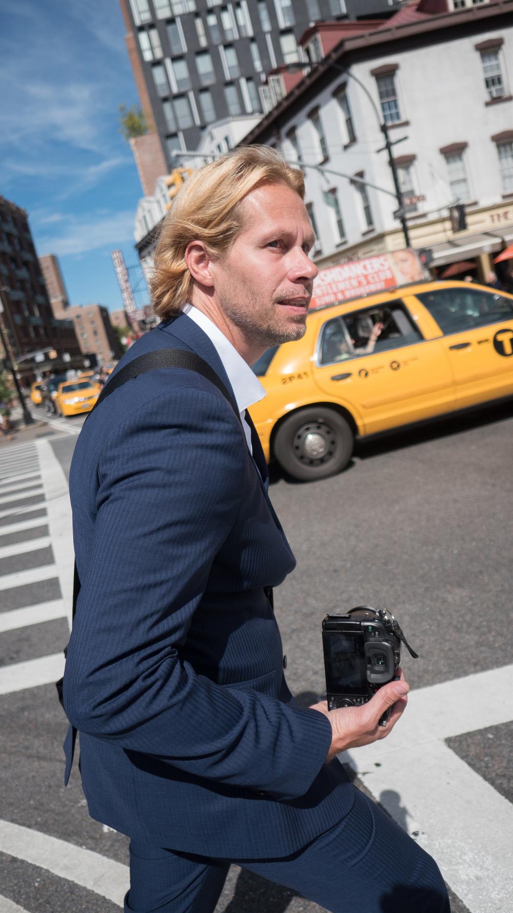Charles bio Blue Suit 2.jpg