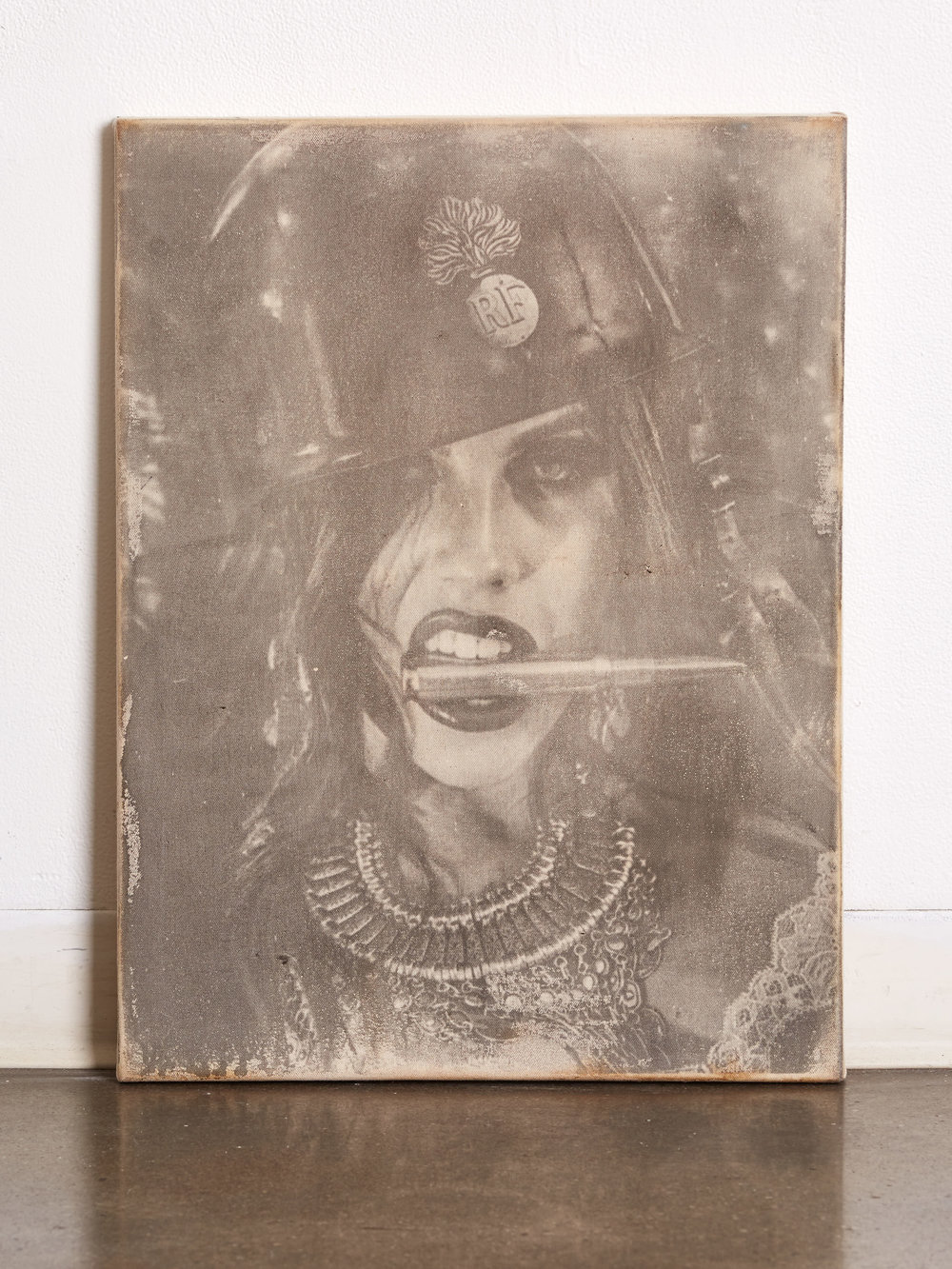 """Bite the Bullet     18x24""""   Experimental Low Contrast Emulsion  Liquid Emulsion Painted on Raw Canvas, Hand-Stretched over 1.5"""" Thick Wood Frame   Ingredients:  Photo (One Femme Fetale, One .50 Caliber Bullet, One French WWI Helmet) Print (Canvas, experimental emulsion, Tecate, Proprietary Chemical Blend & Process)"""