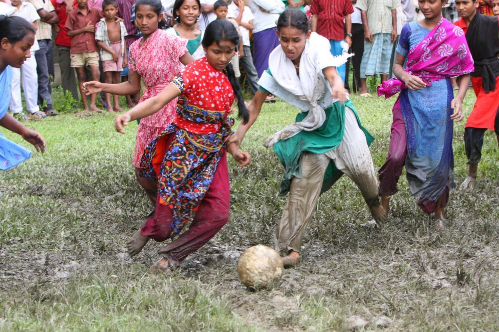 BA Girls playing football Bangladesh very colourful UNI.jpg