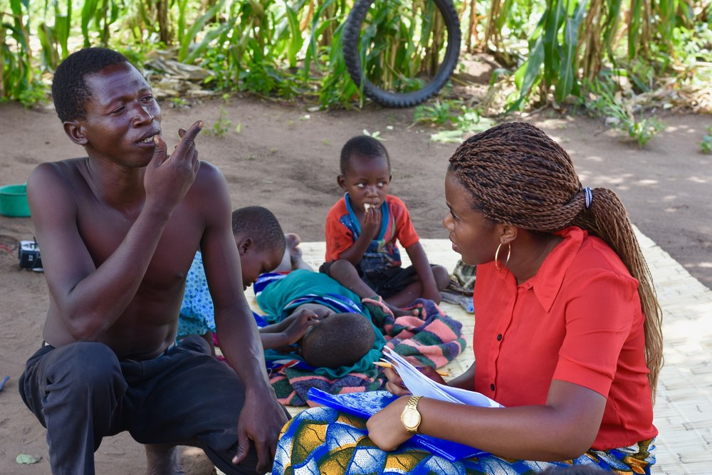 Another UP worker, Vanessa, collects information from a father in Mdala village while his three young children look on, offering occasional contributions.   The survey gathers data, including how many nets each household currently has, if they have been used correctly and how many members of a family share one net. This allows the Unit to gauge its progress and form new strategies.