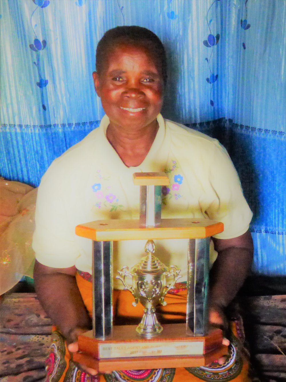Above: Chrissy, pictured with her award for selling the most stoves in the country