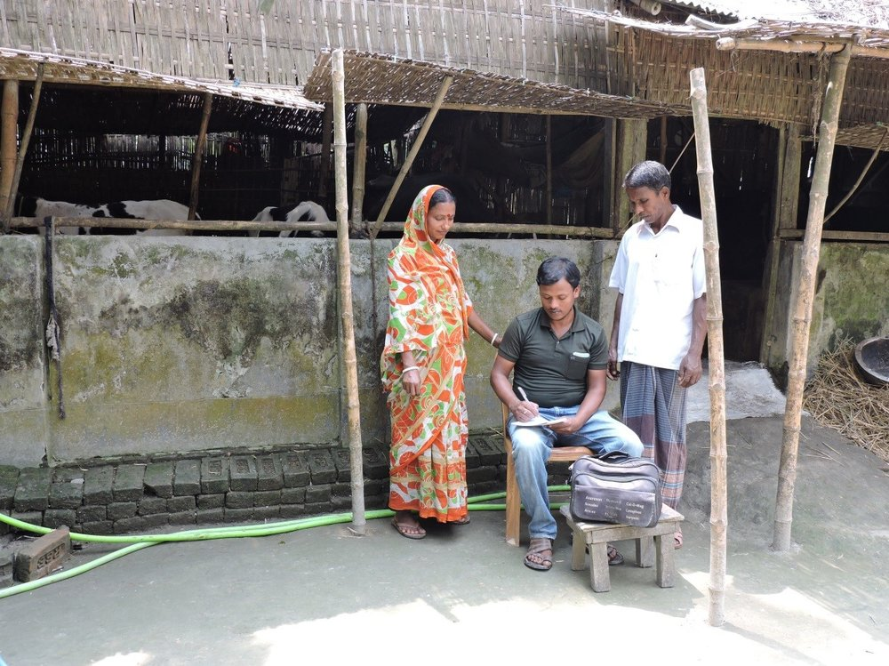 Laheri and her husband receiving information and support from their local business adviser, Mustafizur