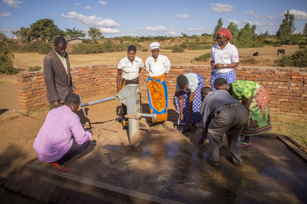 Waterpoint Committee inspect a pump in Phalombe