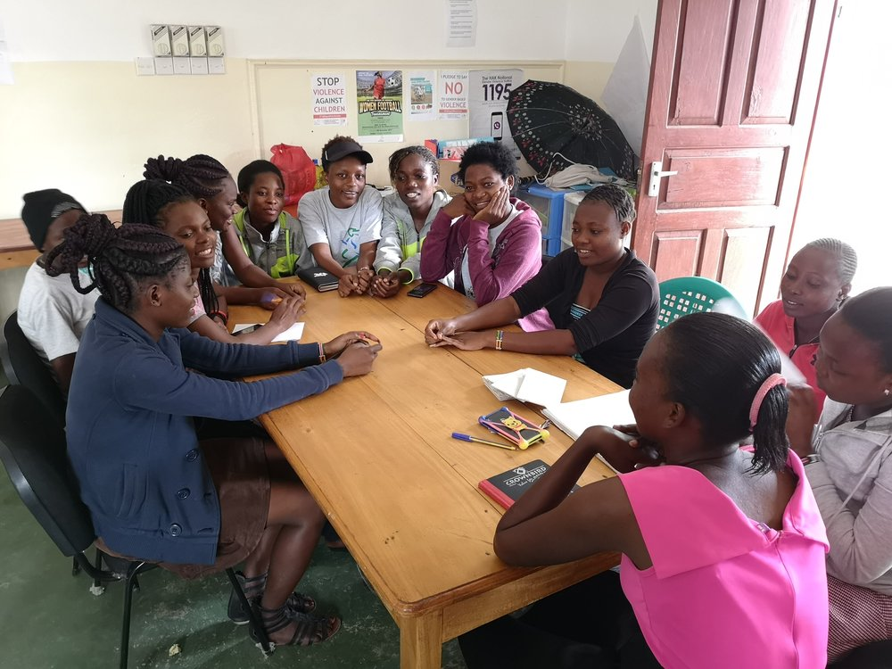 Rose chairs the weekly Mnarani 'Out-of-School Savings Group' meeting.