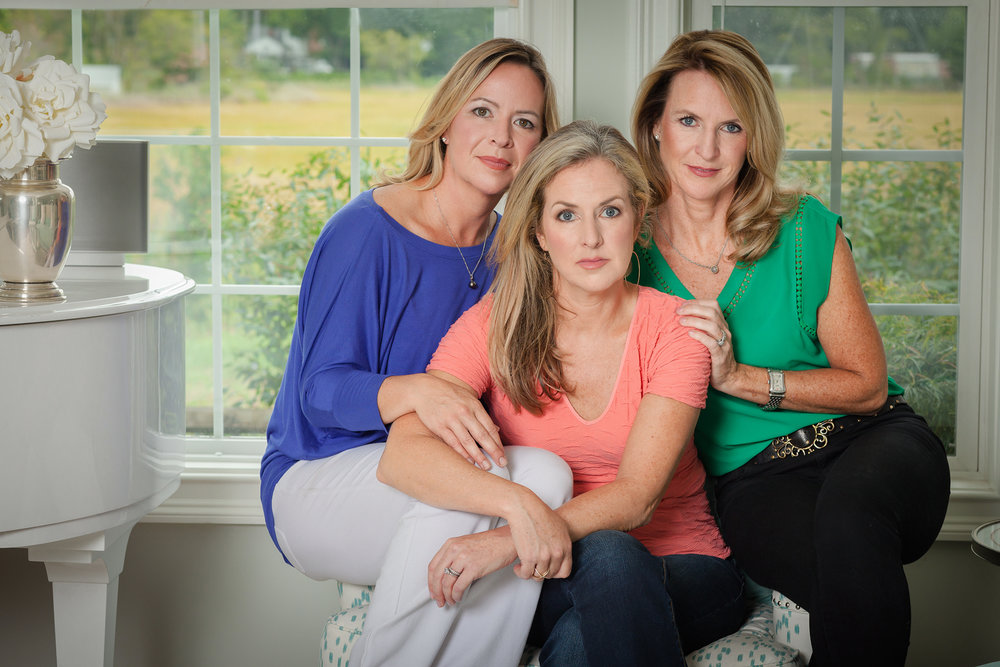 Rebecca Timlin-Scalera (center), photographed with her sisters in her home in Connecticut, founded The Cancer Couch Foundation, which raises funds for metastatic breast cancer research.