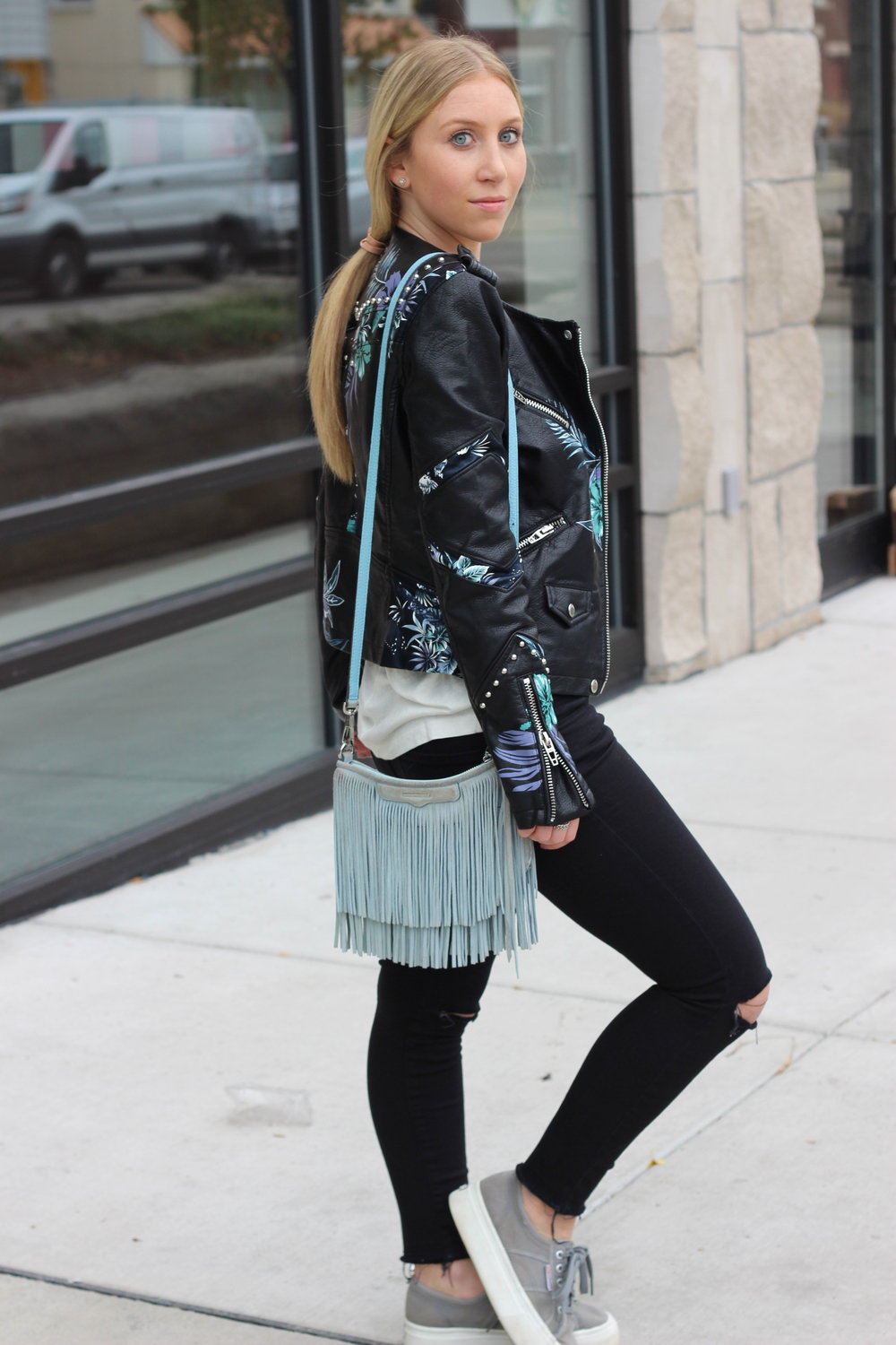 Floral leather jacket black jeans platform sneakers fringe bag Au Courant Life