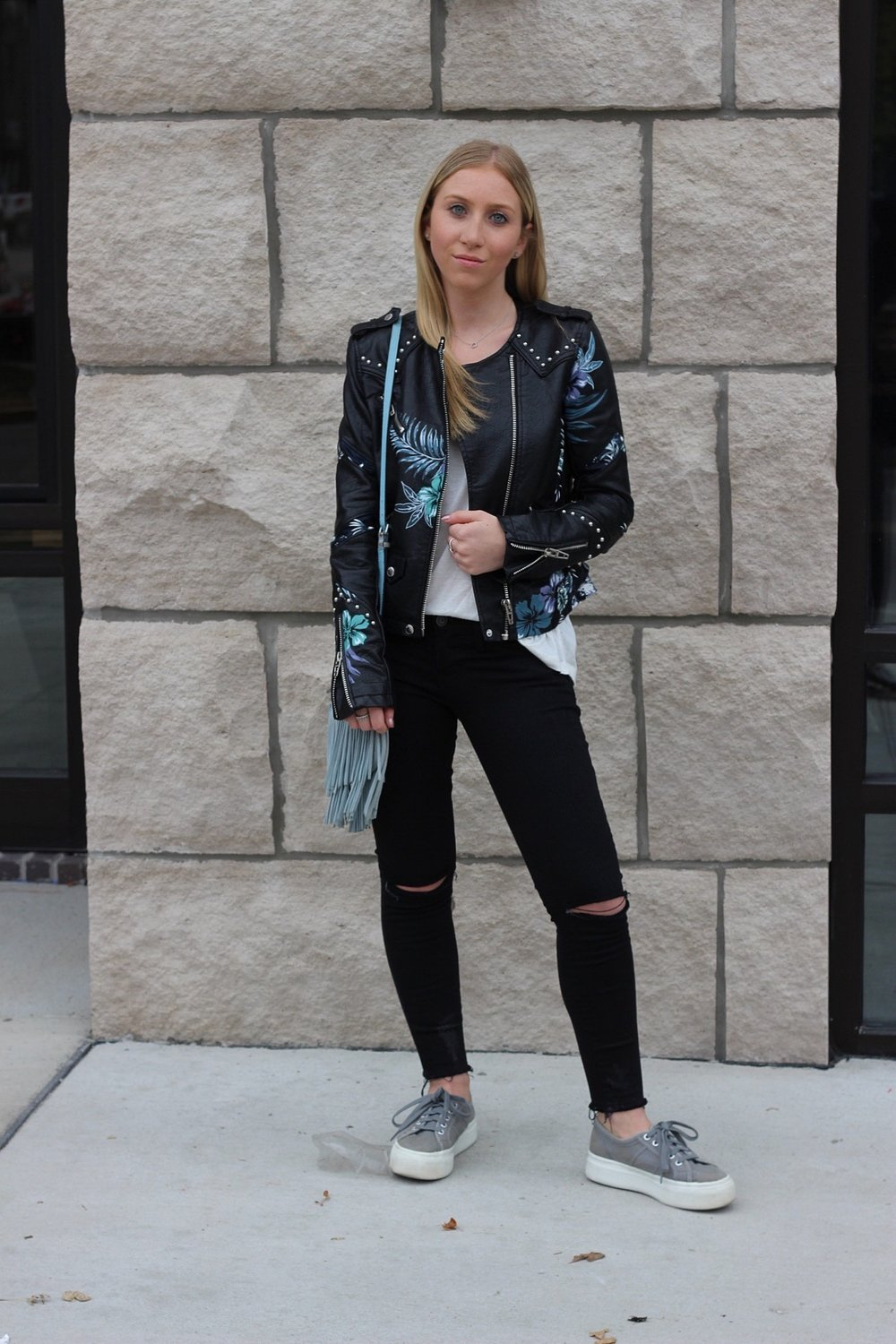 Fall floral moto jacket black ripped jeans platform sneakers fringe bag Au Courant Life
