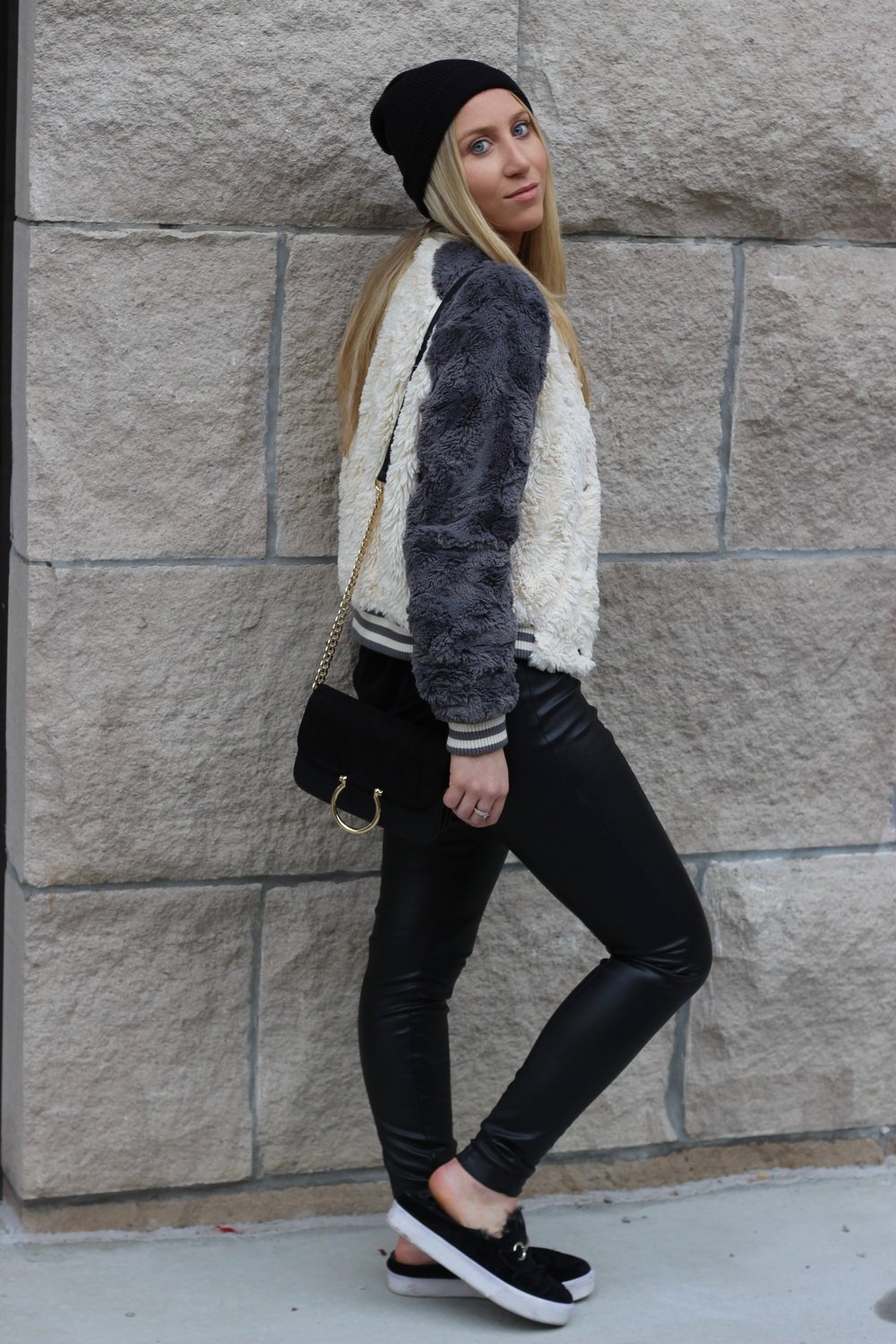 Keeping warm for winter in fur slides fur bomber and knit beanie by Au Courant Life