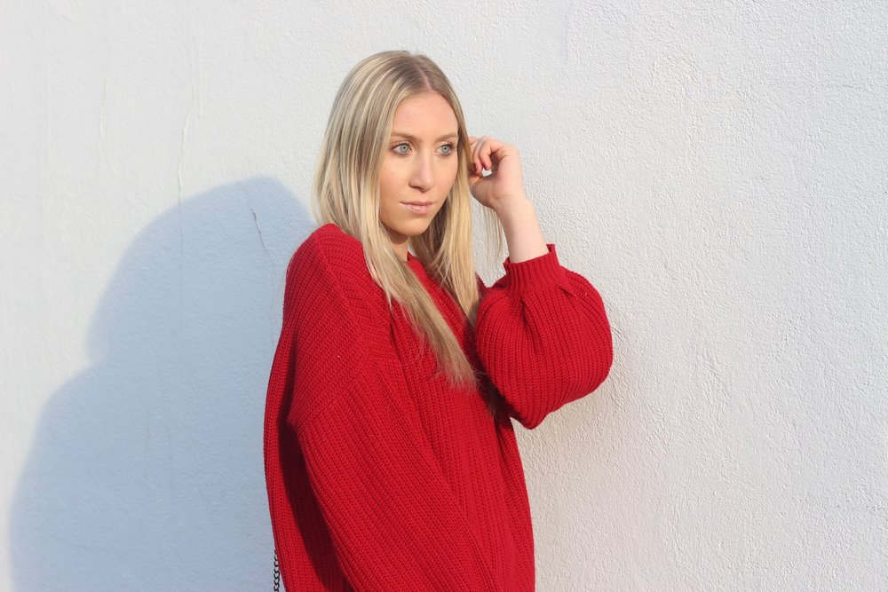 Carly of Au Courant Life in red sweater by Forever 21