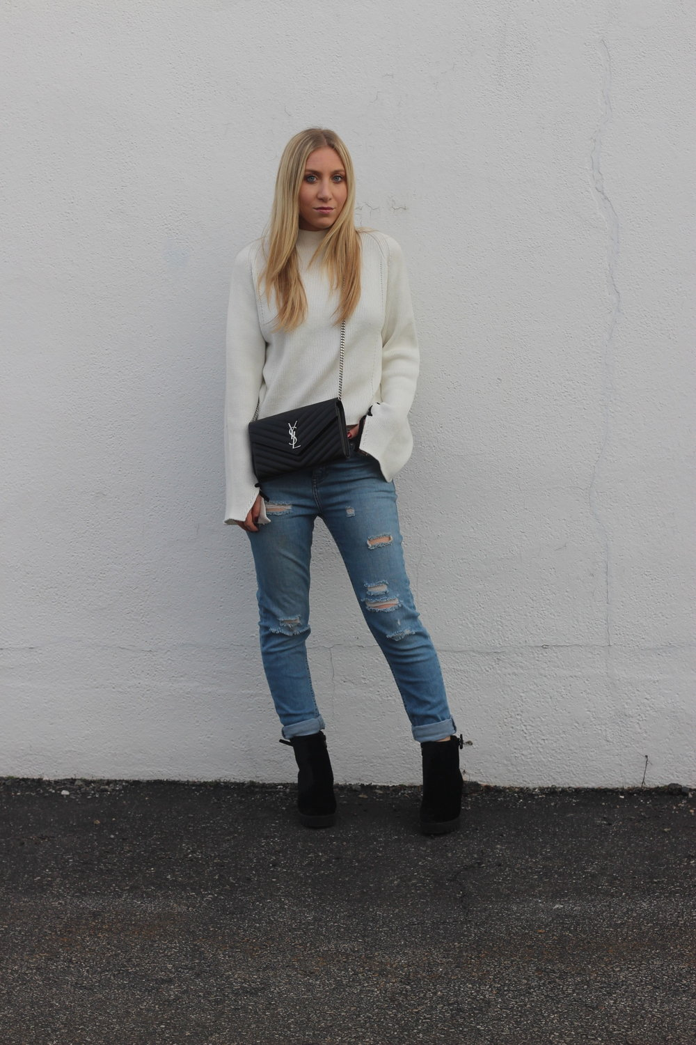 Au Courant Life in boyfriend jeans, booties, sweater, and ysl bag
