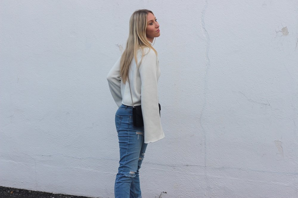 Bell sleeve sweater and boyfriend jeans by Au Courant Life