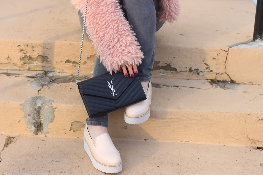 Saint Laurent bag with sol sana slides and Topshop faux fur coat by Au Courant Life