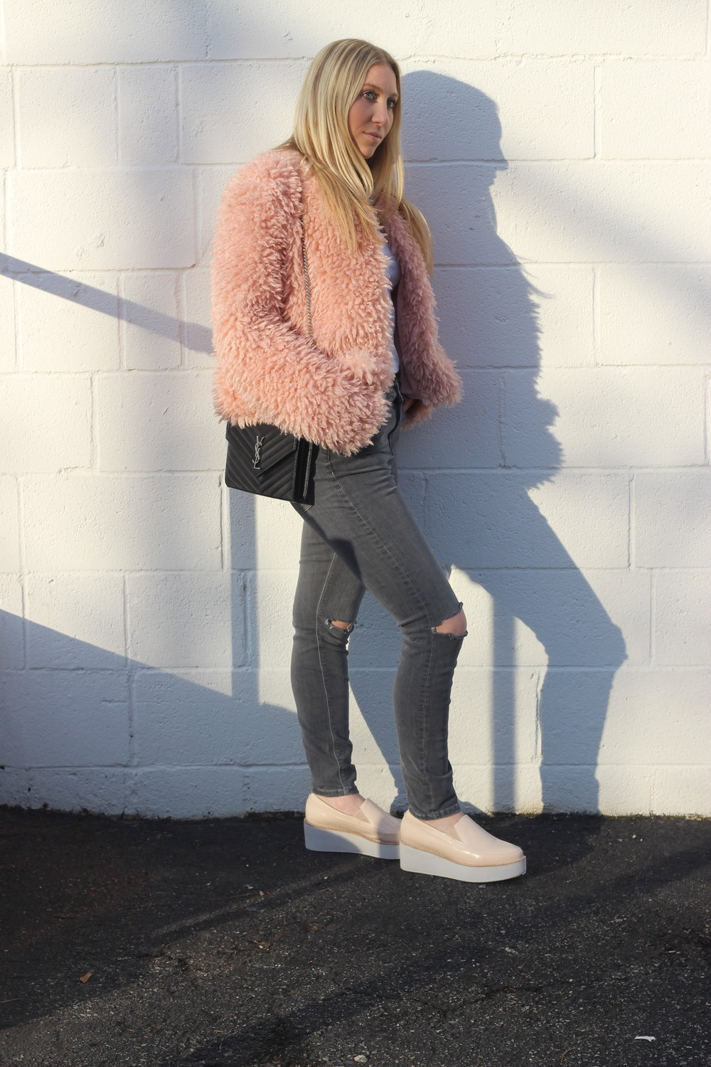 Blush faux fur jacket with grey Topshop Ripped jeans and blush sneaker wedges by Au Courant Life