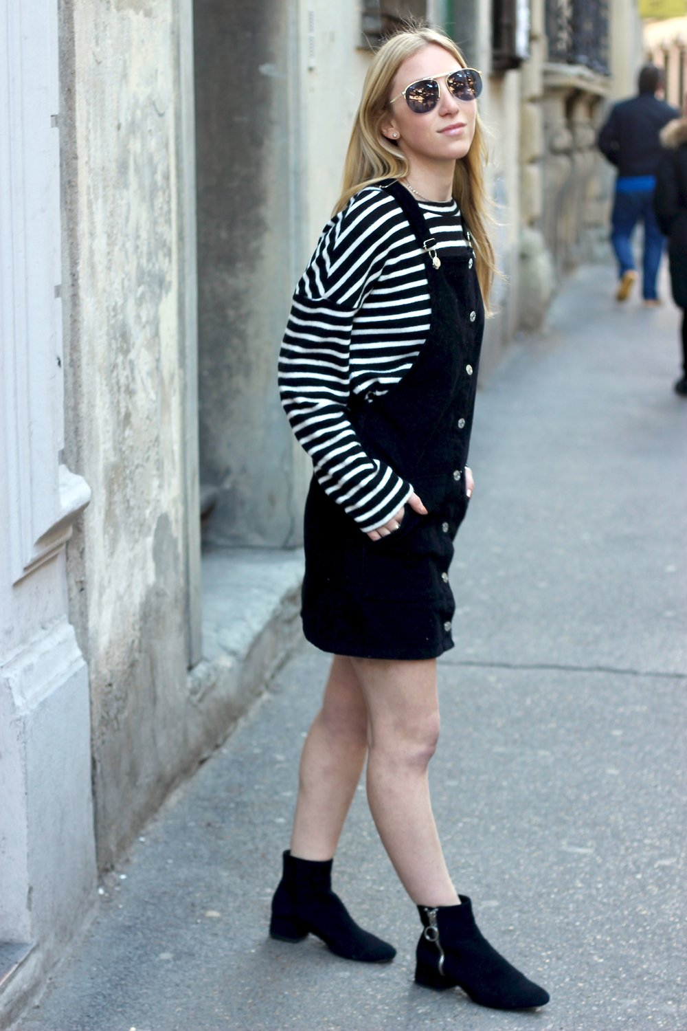 Black overall dress with sweater and booties by Au Courant Life