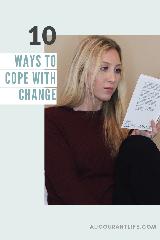 girl sitting reading book cope with change by au courant life