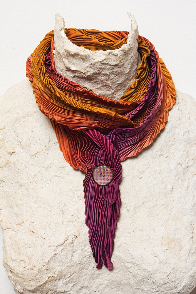 Arashi Shibori dyed silk petal scarf with a hand-painted button.
