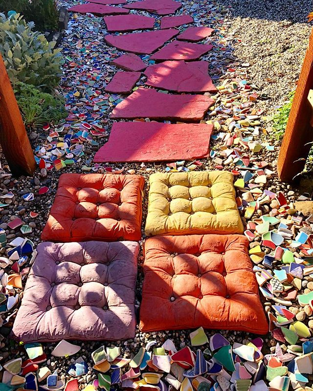 I'm redoing my front walkway under the new arbor. It's a work in progress. The pillows are concrete! #landscape #design #justforfun #tuffets #polished #pottery #shards. #arbor #path #walkway #welcome