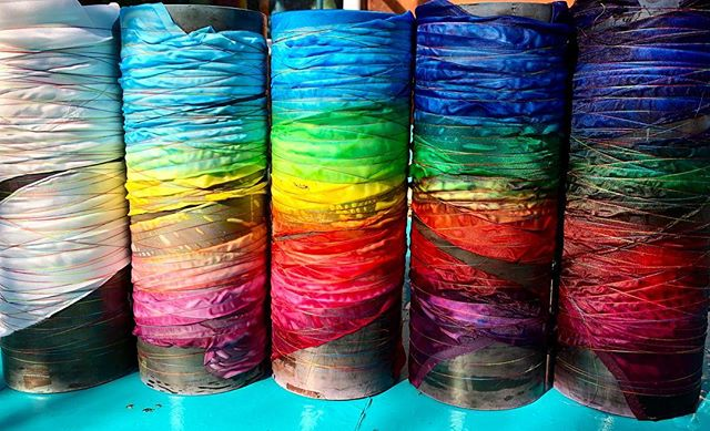 What do we have here? Well, when Craft in America visits next week, I have been asked to do a shibori dye demonstration in front of the cameras. My normal time consuming process of delicately layering dye, is not conducive to filming, unless they have all day, which they don't. So, today I dyed a series of wrapped poles, halting the process in various stages of completion. The one on the right is basically done. The one on the left, not dyed at all. This way I can demonstrate the process in record time, with, hopefully, nice results. #timewilltell  #behindthescenes  #insidethesilkstudio #celebrating #handmade #craft #textiledesign #fiberart #artquilt #shibori #art #education #silk #hand-dyed  @craftinamerica