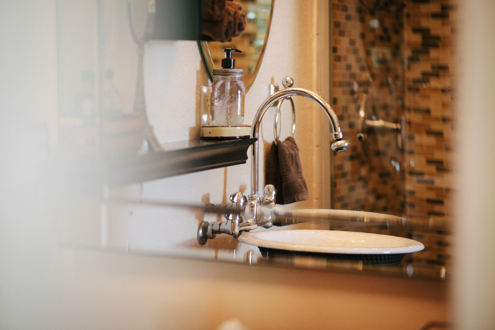 The Latte Room bathroom, an en suite beauty, boasts a cast-iron vessel sink where an old fireplace used to be.