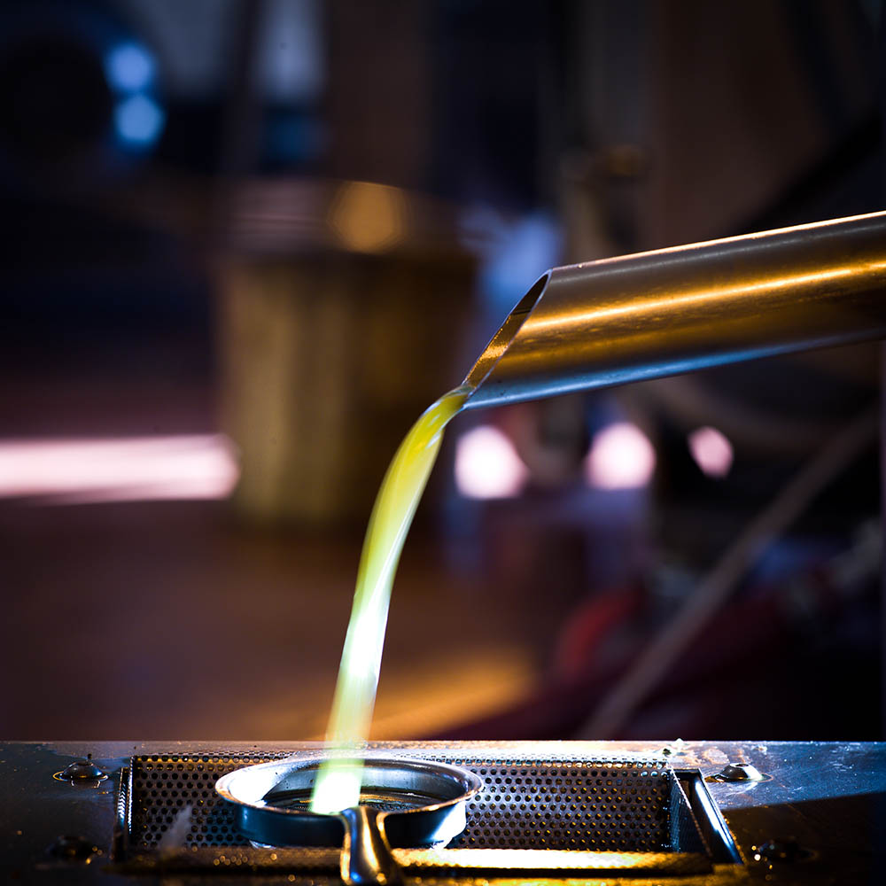 Filtering freshly pressed olive oil at Rish Lakish, Zippori