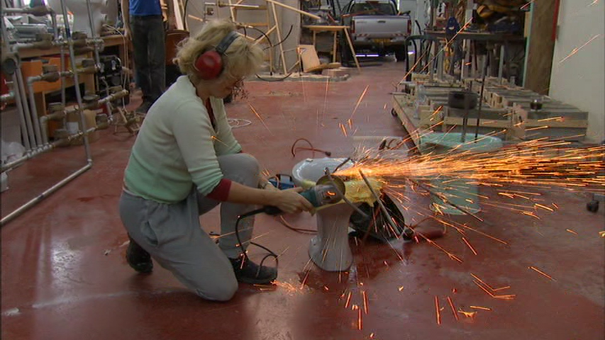 A still of artist Sigalit Landau welding in the film  Out in the World