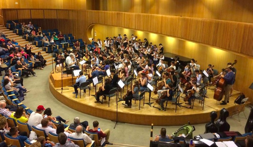 "Itzhak Perlman conducts ""Can Can"" and Haydn's Toy Symphony with the Perlman Music Program Orchestra and 40 young Israeli String Players at the Israel Conservatory Tel Aviv. Photo courtesy The Perlman Music Program"