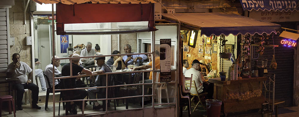 Socializing at Jerusalem's Machane Yehuda in the evening. Photo by and © Vision Studio