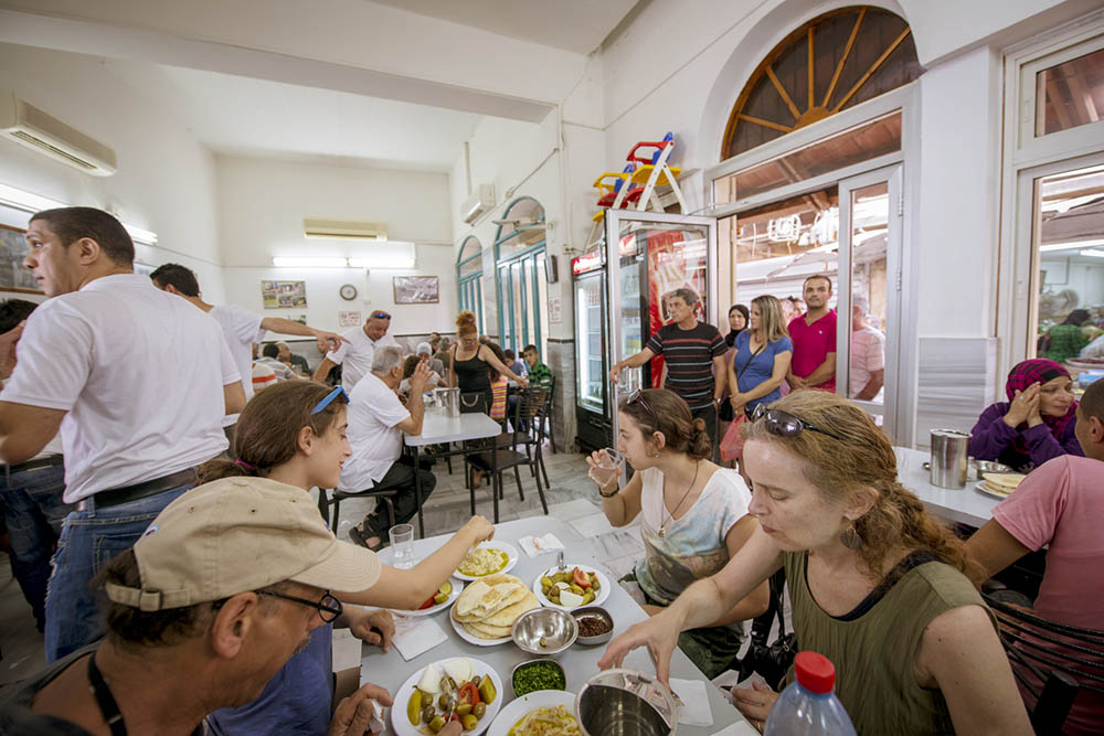 Happy customers at the Sa'id hummus shop, Akko. Photo by and © Vision Studio