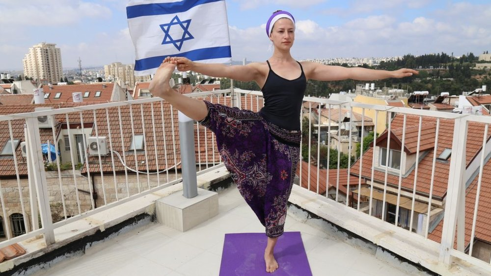 Rooftop Yoga in Jerusalem with instructor Ayo Oppenheimer-Abitbol, overlooking the Israeli Parliament and Judean Hills. Photo by David Abitbol/Jewlicious