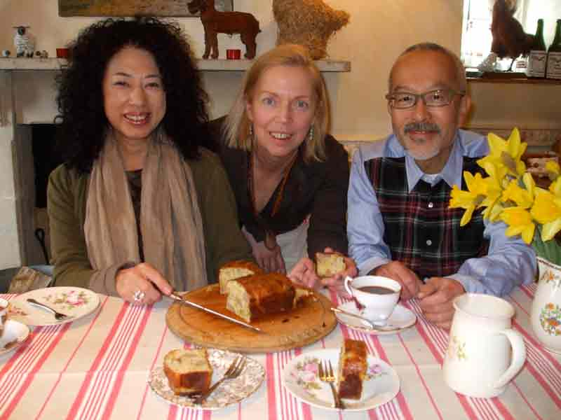 Photo Credit: Caron Cooper/Fosse Farmhouse;   Yasuko Mitani and Shozo Mitani the owners of the English B&B in Japan dine at Fosse Farmhouse with Caron Cooper (center).