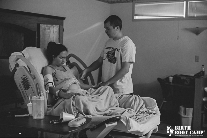 Husband supporting wife during hospital birth
