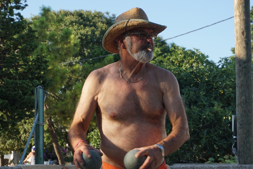 A photo of pops playing Bocce Ball. This game is a staple on the island, and pretty much every afternoon after lunch, you can see Slavko and the other men (young and old) either playing or watching Bocce Ball by Sasha's cafe. Sometimes there are only 4/5 people watching, but other days like yesterday (8/7/16) there were 30!