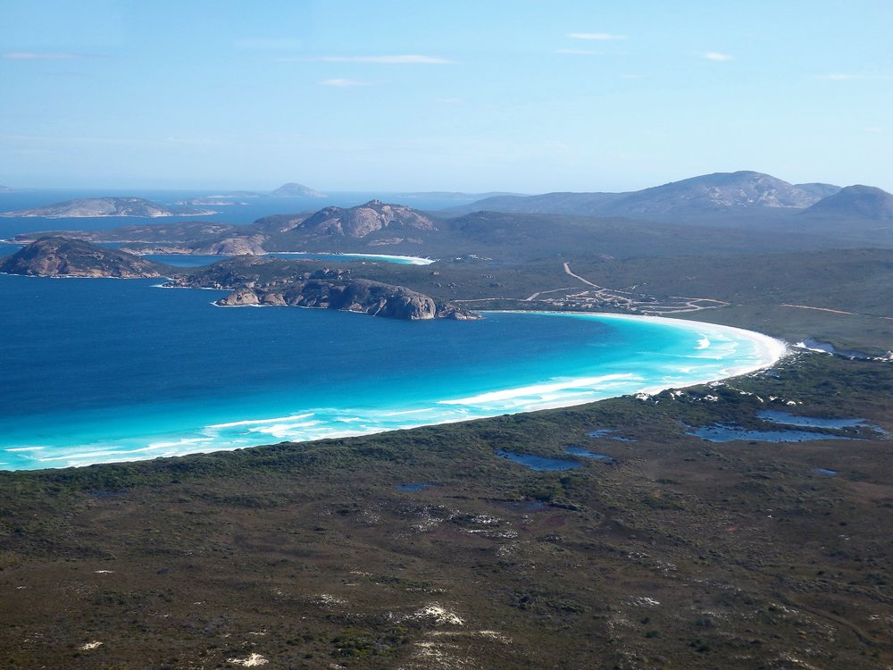 Esperance-Cape Le Grand Flight -  See 10 Mile Lagoon Windfarm, along the cliffs and beaches including Twilight Beach, and across the Islands of Esperance Bay to Cape Le Grand National park, Lucky Bay and Frenchman Peak, before heading back via Esperance town and PortCLICK HERE for more info.