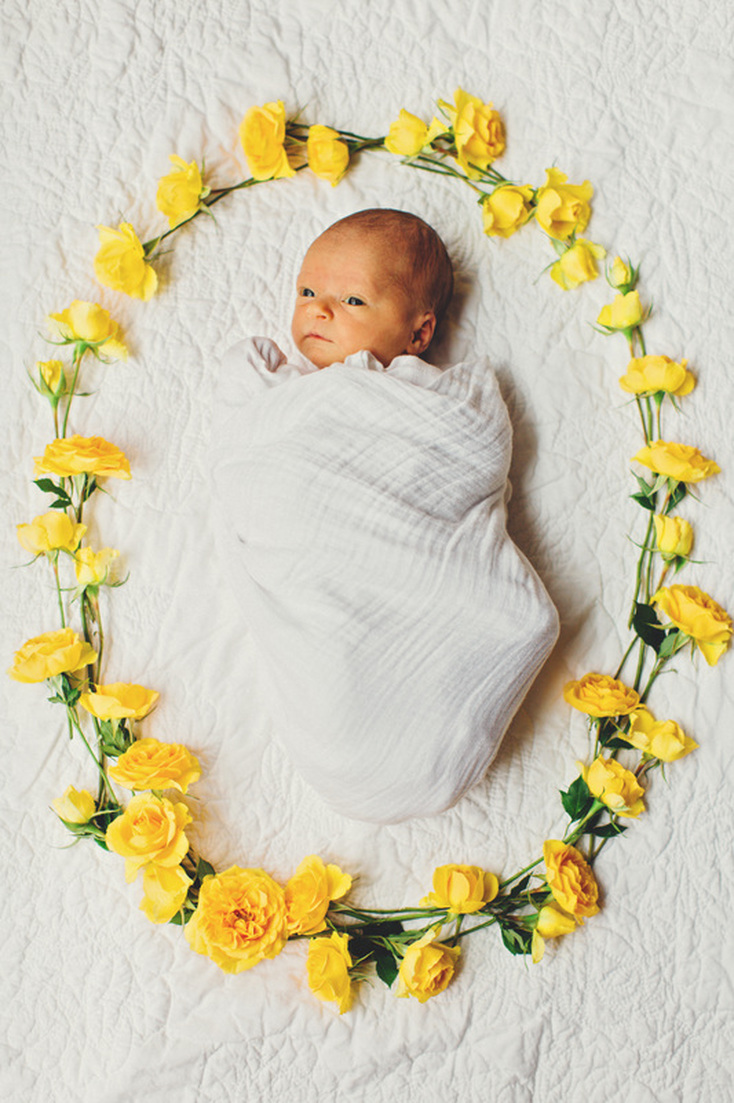 Atlanta, Georgia newborn photography. Lifestyle newborn photography. Four Corners Photography. Baby surrounded by flowers.