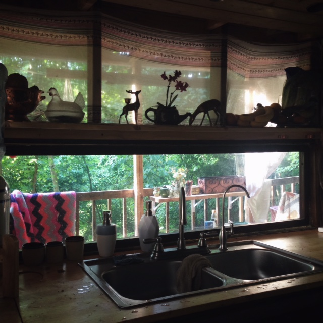 One half of her kitchen and the view from her window.
