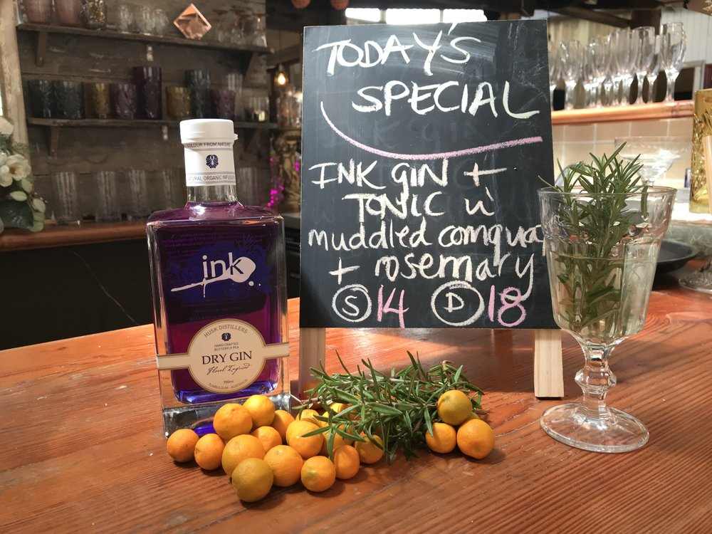 Muddled Rosemary, freshly foraged Cumquats from the cafe garden, edible pansies are all a part of the Gin Decor.