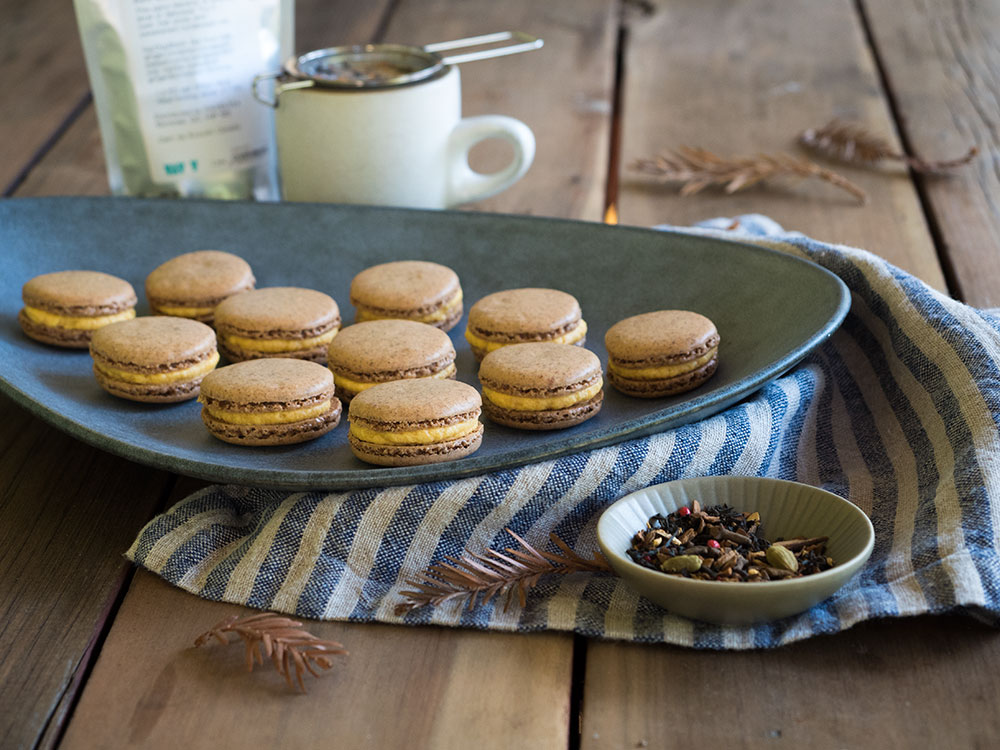 Spicy chai tea cookies and pumpkin buttercream come together to create this warm and cozy fall macaron. Get the recipe plus the tips and tricks I found to baking technically perfect macarons.