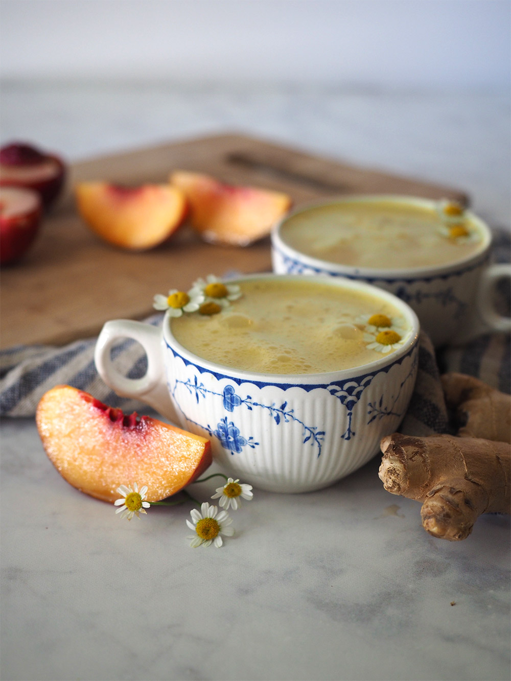 This vegan tea latte combines farmers market fresh peaches with cozy chamomile tea, fresh ginger root, coconut oil and cardamom to make the perfect end of summer elixir.