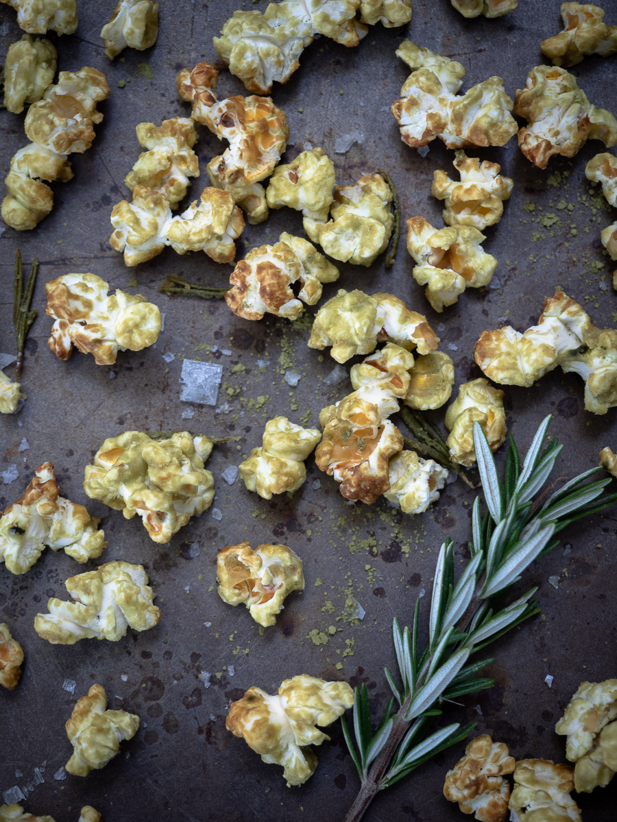 This gluten free popcorn mix is made with matcha green tea and white chocolate and baked for the perfect complex flavor. It's the perfect snack for holiday parties.