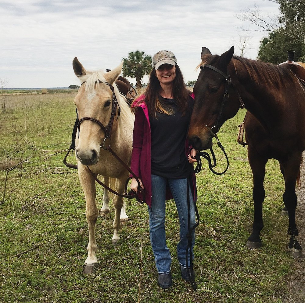 Tracy, with a couple of her favorite equine friends.