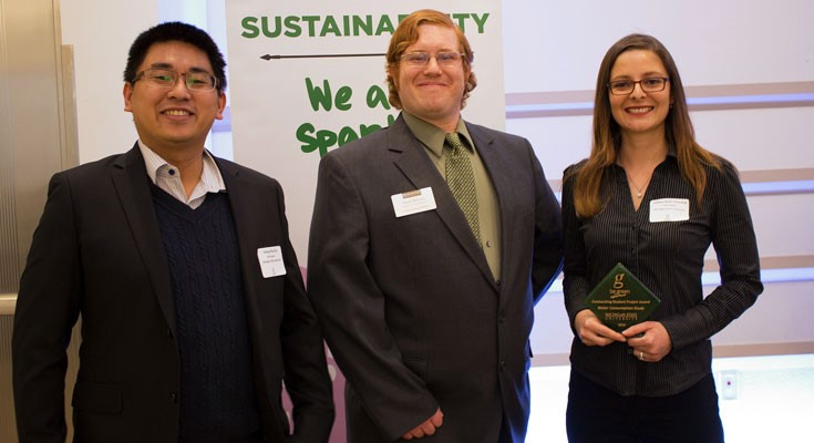 The Water Study Team members Cheng-Hua Liu and Melissa Rojas-Downing pose for a photo with MSU Sustainability Coordinator Sean Barton. The team was recognized with an award at the 2016 Be Spartan Green Award Gala for their campus water consumption research. Photo courtesy of MSU Sustainability.
