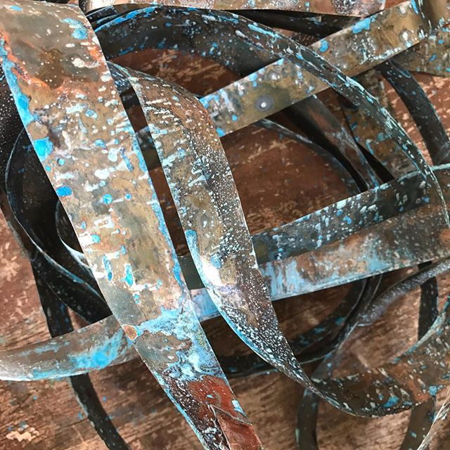 S T A R T I N G a new project with ribbons of copper ready to weave into another pendant light. #copperlight #copper #copperpatina #copperbydesign #cbdcustommade #copperlightproject