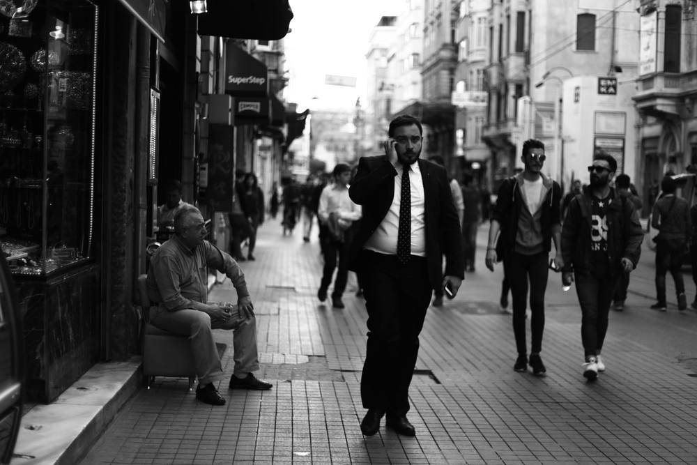 man in a suit walking.jpg