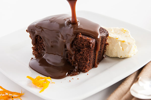 Sticky Chocolate Orange Pudding  A rich chocolate orange sponge pudding with a luxurious orange and swiss chocolate sauce.