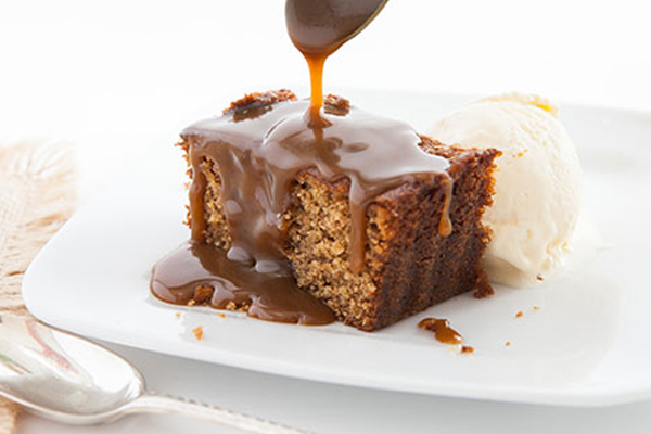 Sticky Toffee Pudding   A buttery date sponge pudding smothered with lashings of rich toffee sauce.