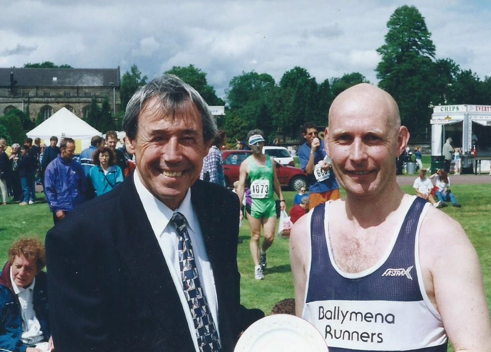 Roy being presented with the Potteries Marathon Finishers Plate by England World Cup winning 'keeper Gordon Banks