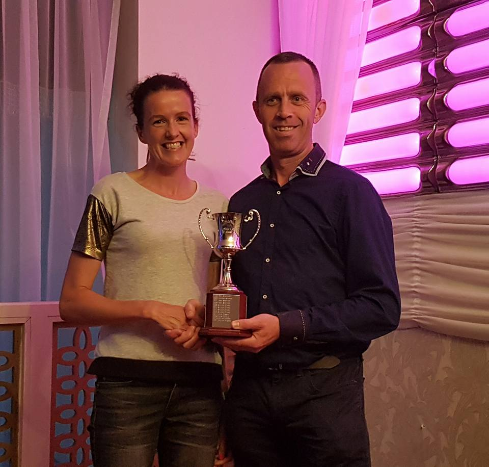 Gillian Wasson receives her prize for finishing first in her Hill n Dale Female age category